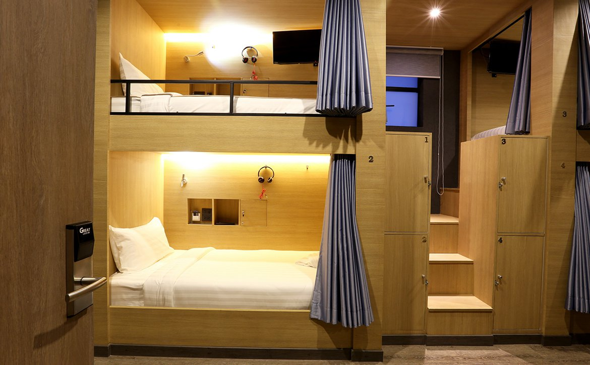 FOUR BUNK BEDS WITH SHARED BATHROOM